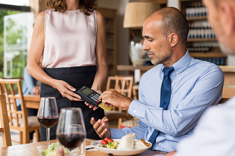 man paying by credit card